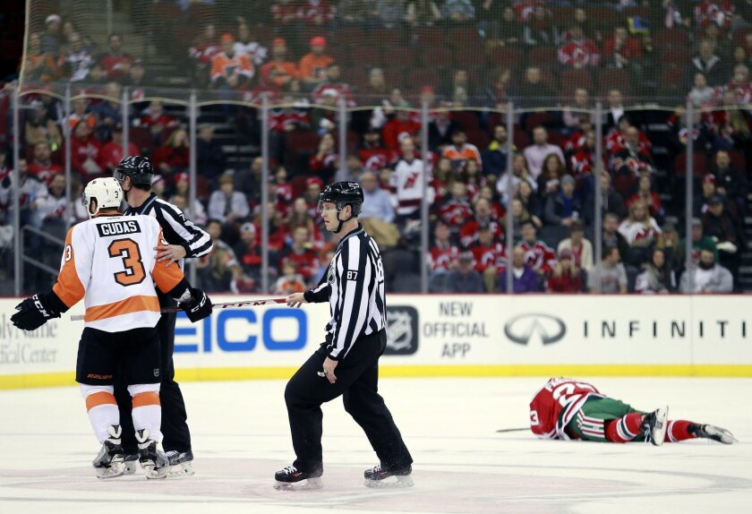 Philadelphia Flyers defenseman Radko Gudas (3), of the Czech Republic, is ejected after a hit on New Jersey Devils right wing Bobby Farnham, far right, during the first period of an NHL hockey game, Tuesday, Feb. 16, 2016, in Newark, N.J. (AP Photo/Julio Cortez)