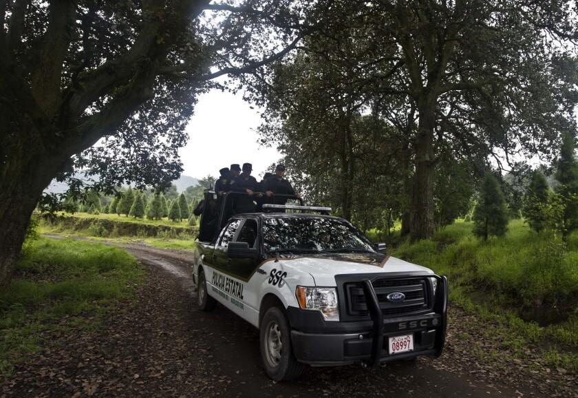 Mexican police on patrol near Mexico City