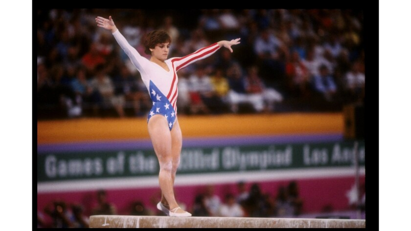 Mary Lou Retton in action on the balance beam during the 1984 Summer Olympics in Los Angeles.