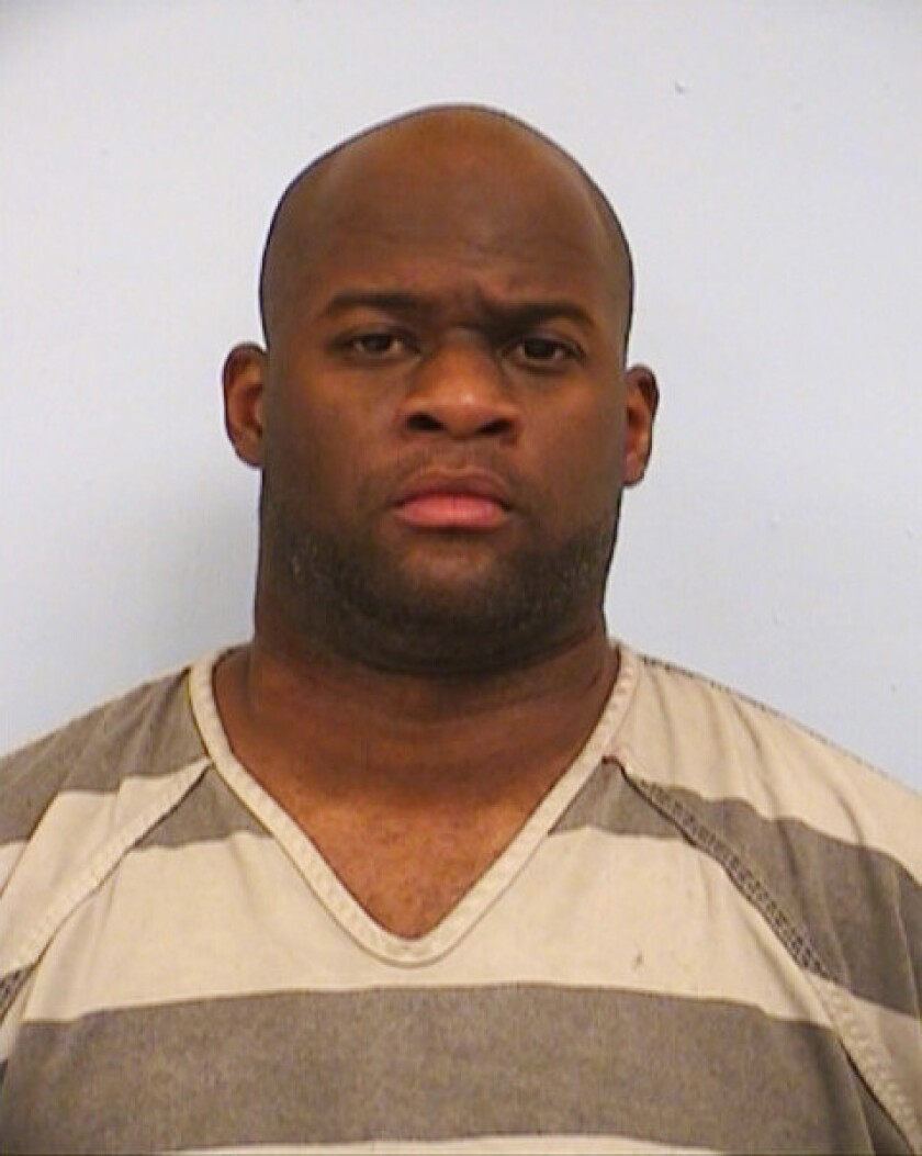 Vince Young, shown in a photo provided by the Austin Police Department, was arrested late Sunday on suspicion of driving while intoxicated.