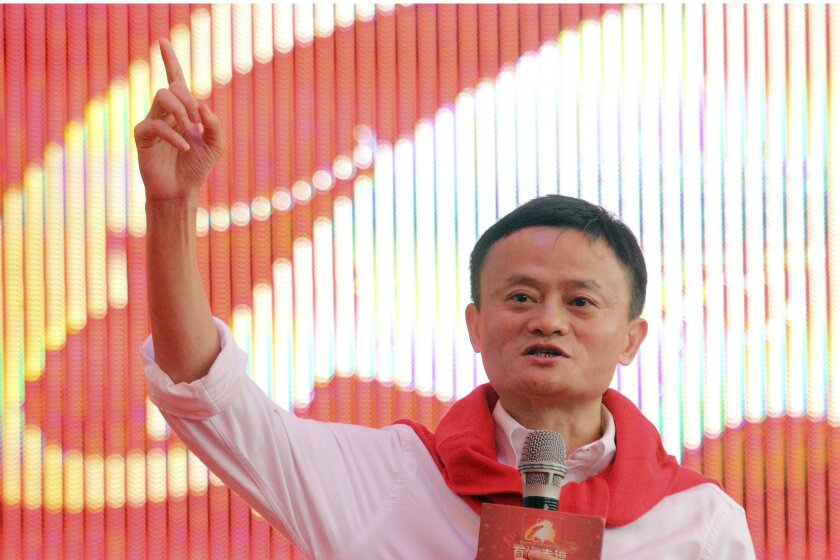 In this photo taken Friday May 9, 2014, Jack Ma, founder and Executive Chairman of Alibaba Group, speaks to newly weds employees of the company during a group wedding held 102 couples in Hangzhou in east China's Zhejiang province. Foreigners who want to buy Alibaba Group shares in the Chinese e-commerce giant's U.S. public offering will need to get comfortable with an unusual business structure.(AP Photo) CHINA OUT