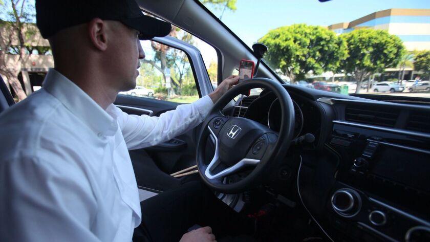 Bill Tesauro checks his phone map before heading back to work.