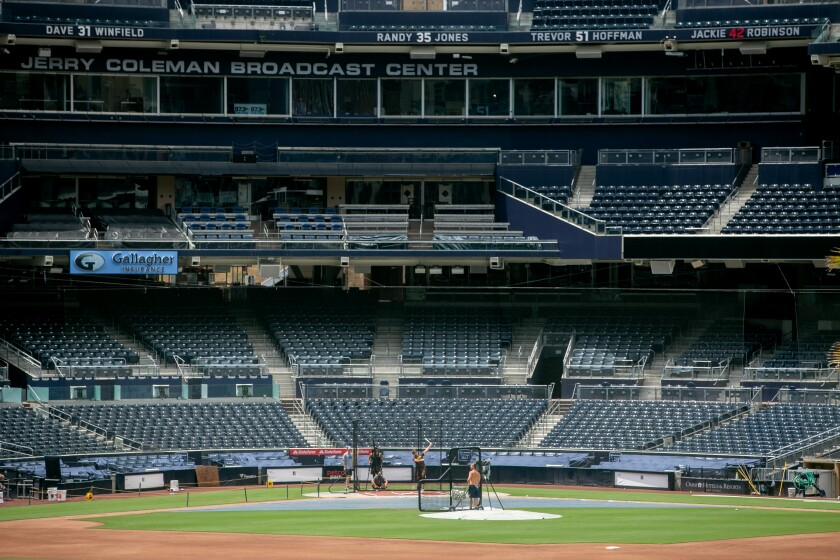 Padres players taking batting practice at Petco Park. There won't be many more people in the seats once the season starts.