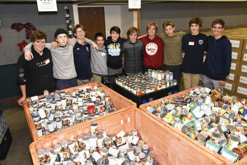San Dieguito Academy Polo team helped sort and assemble the food donations