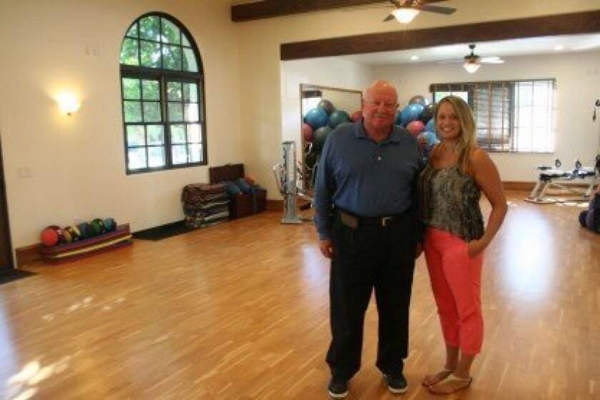 Crosby Club's Ed Sanabria and Kira Haley in the renovated group exercise room. Photo by Karen Billing