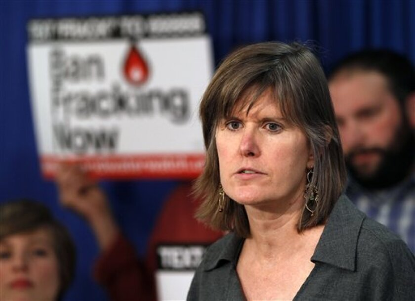 "FILE - In this March 26, 2012 file photo, author Sandra Steingraber speaks during a ""New Yorkers Against Fracking"" news conference in Albany, N.Y. While New York regulators have spent four years mulling the environmental impacts of shale gas development, the potential human health impacts have been"