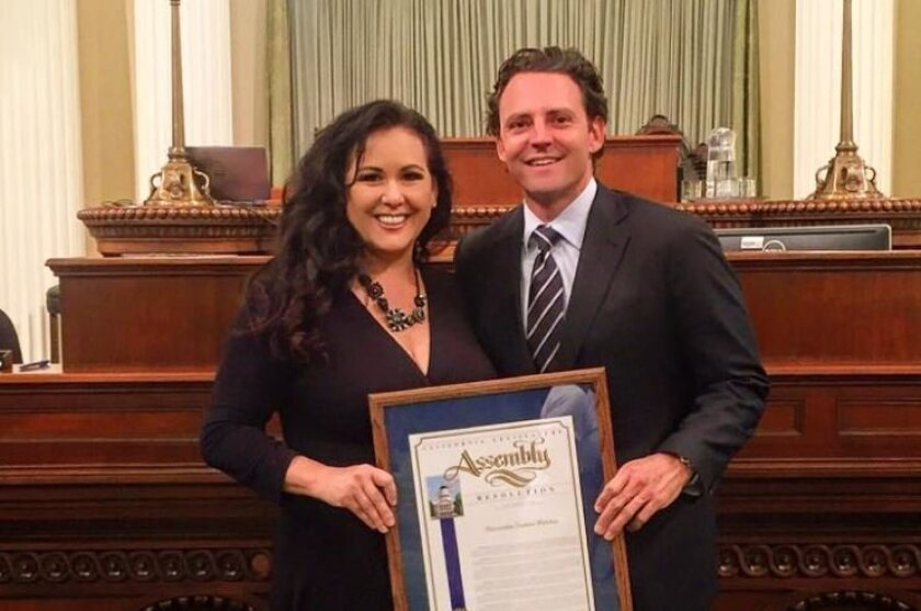 Former California Assemblyman and military veteran advocate Nathan Fletcher receives the 2016 Veteran of the Year award from his girlfriend and Assemblywoman Lorena Gonzalez, D-San Diego, for his wo