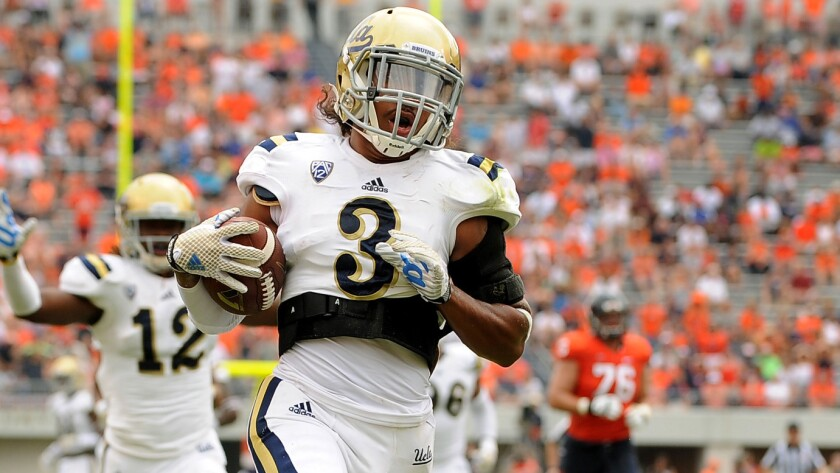 UCLA safety Randall Goforth scores on a fumble return during a win over Virginia.
