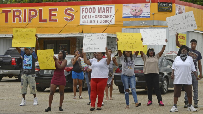 Family and friends of Alton Sterling protest on the Baton Rouge, La., street corner where he was shot and killed by police.