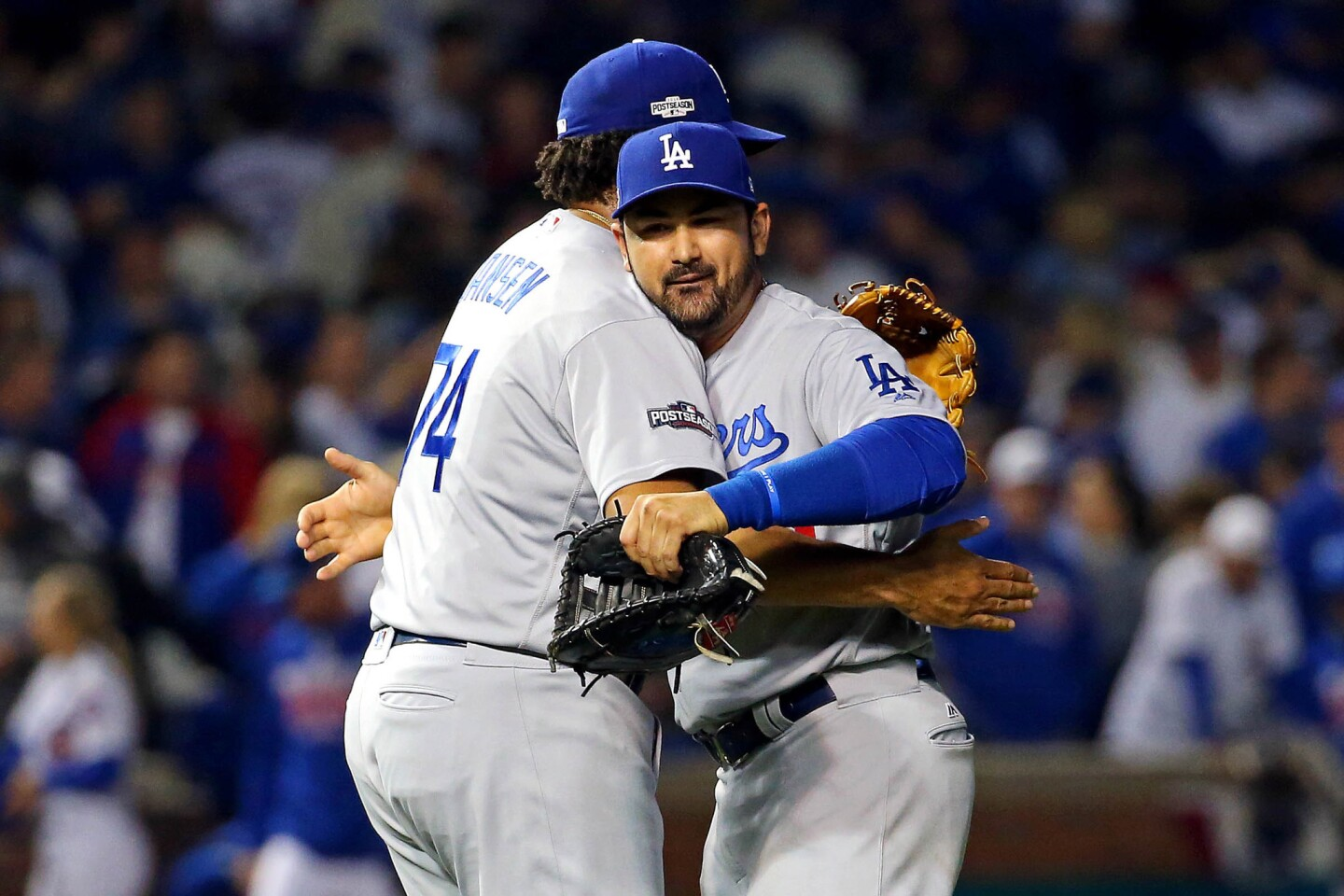 Oct 16, 2016; Chicago, IL, USA; Los Angeles Dodgers first baseman Adrian Gonzalez (23) and relief pitcher Kenley Jansen (74) celebrate after beating the Chicago Cubs in game two of the 2016 NLCS playoff baseball series at Wrigley Field. Mandatory Credit: Jerry Lai-USA TODAY Sports ** Usable by SD ONLY **