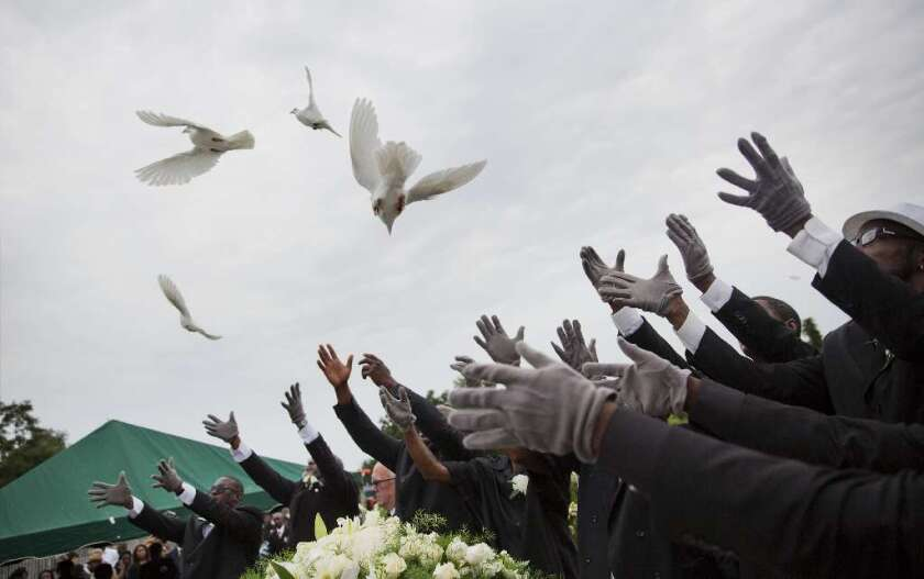 Pallbearers release doves over the casket of Ethel Lance during her burial service, Thursday, June 25, 2015, in Charleston, S.C. Lance was one of the nine people killed in the shooting at Emanuel AME Church in Charleston.