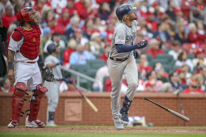 Cardinals catcher Yadier Molina can only watch as Fernando Tatis Jr. of Padres begins his home-run trot following two-run shot Friday in St. Louis.