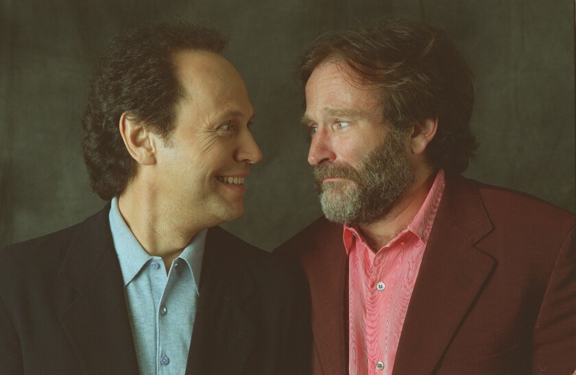 """Billy Crystal, left, and Robin Williams together in 1997 to promote their movie """"Father's Day."""""""