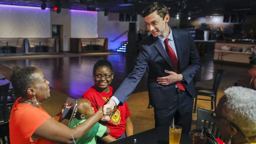 epa06017906 Democratic US House of Representatives candidate Jon Ossoff (R) campaigns at a restauran