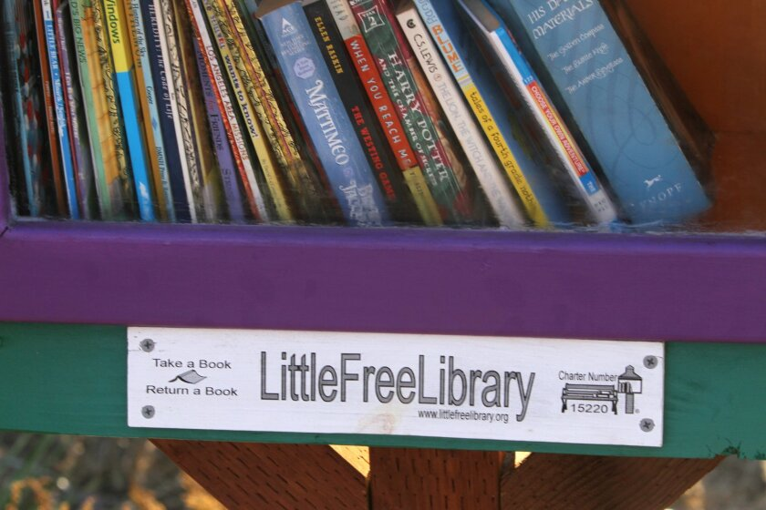 The official designation sticker on the little library in Vista. photo by Bill Wechter