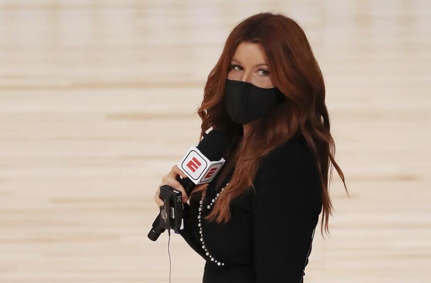 ESPN reporter Rachel Nichols stands on the court before an NBA basketball game