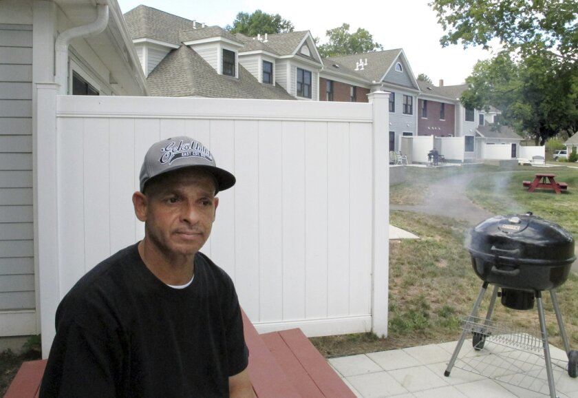 FILE - In this Aug. 27, 2015, file photo, Luis Vazquez, a Navy veteran who was homeless off and on for 10 years, sits outside his home in a veterans' housing complex in Newington, Conn. In August, the federal government declared Connecticut the first state to end chronic homelessness among veterans