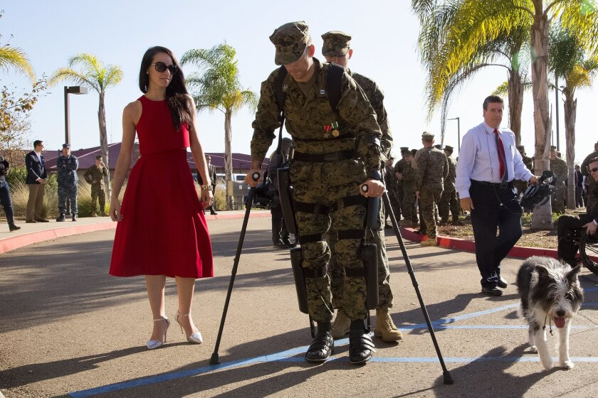 Capt. Derek Herrera, a special operations officer in the U.S. Marines along with his wife Maura and his service dog Shaggy left his award and retirement ceremony on Camp Pendleton.