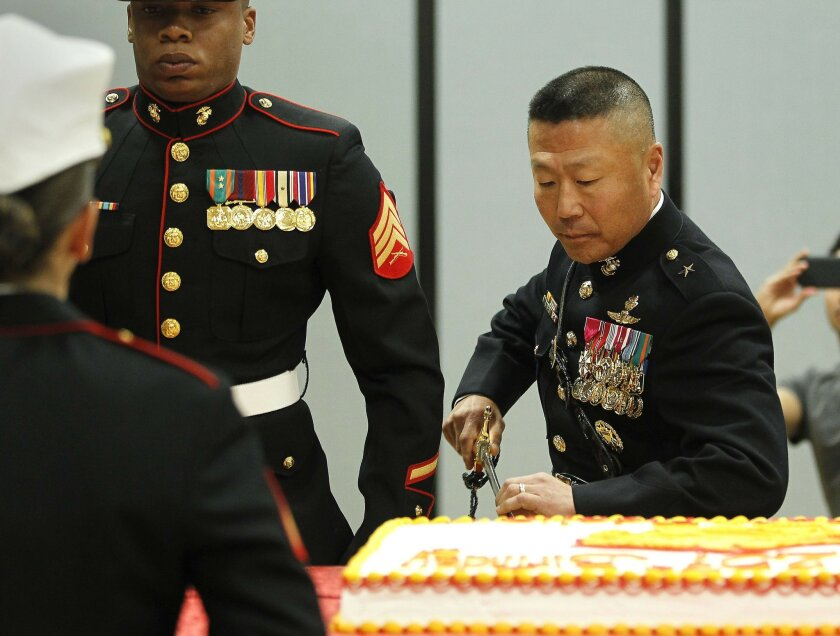 Brigadier General Daniel D. Yoo, commanding general of MCRD cut the first piece of USMC birthday cake.