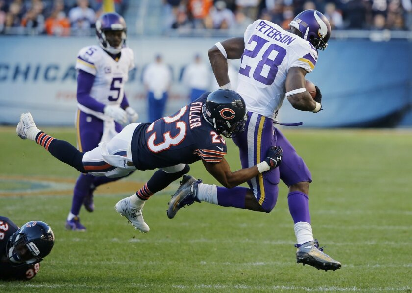 Chicago Bears cornerback Kyle Fuller (23) tackles Minnesota Vikings running back Adrian Peterson (28) during the second half of an NFL football game, Sunday, Nov. 1, 2015, in Chicago. The Vikings won 23-20. (AP Photo/Charles Rex Arbogast)