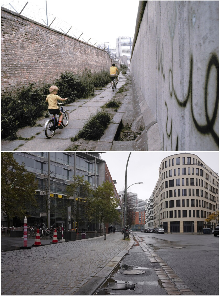 This combination of photos shows a father and son, top, riding their bicycles along a section of the Berlin Wall in Berlin on July 1981 and the same location Nov. 3, 2019. (AP Photo/Markus Schreiber)