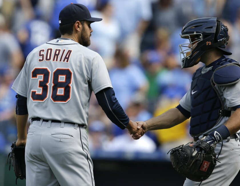 Detroit Tigers relief pitcher Joakim Soria (38) shakes hands with catcher Alex Avila, right, following a baseball game against the Kansas City Royals at Kauffman Stadium in Kansas City, Mo., Sunday, May 3, 2015. Soria picked up a save. The Tigers defeated the Royals 6-4. (AP Photo/Orlin Wagner)