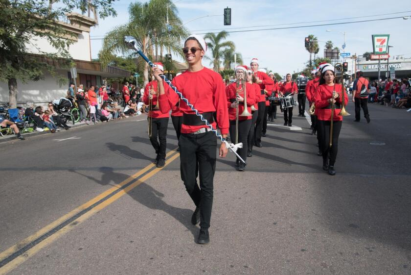 Marching bands perform holiday tunes.