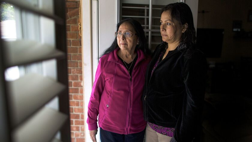 Bianca Salgado,left, and Leticia Zelaya are holding out hope that their granddaughter and niece Mayra Machado,31, will get released from an immigration detention in Louisiana where she's been held for about a year.