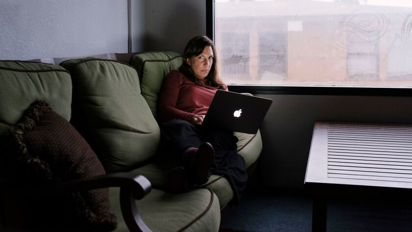 Brooke Binkowski, the managing editor of Snopes, in an office at Proper Media that overlooks the beach.