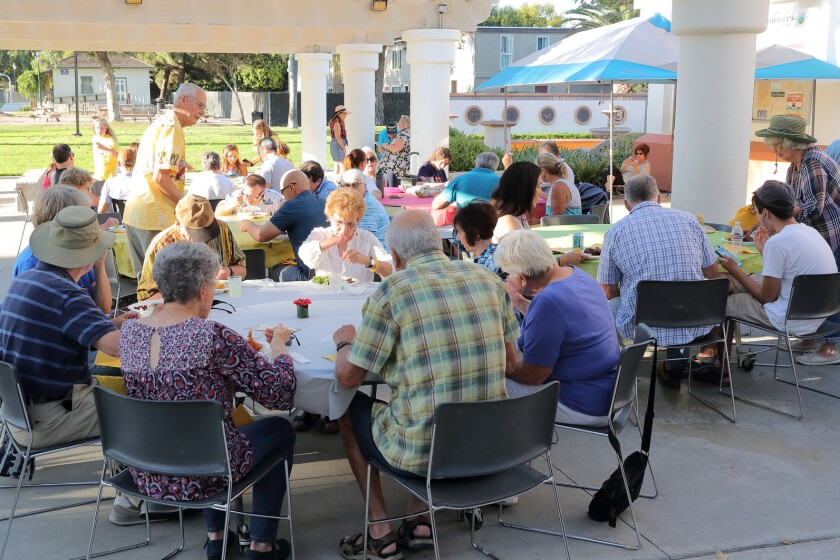 Locals enjoy a barbecue hosted by the Solana Beach Historical Society