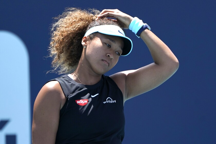 """FILE - Naomi Osaka, of Japan, reacts during her match against Maria Sakkari, of Greece, in the quarterfinals of the Miami Open tennis tournament in Miami Gardens, Fla., in this Wednesday, March 31, 2021, file photo. Sakkari won 6-0, 6-4. Naomi Osaka withdrew from the French Open on Monday, May 31, 2021, and wrote on Twitter that she would be taking a break from competition, a dramatic turn of events for a four-time Grand Slam champion who said she experiences """"huge waves of anxiety"""" before speaking to the media and revealed she has """"suffered long bouts of depression.""""(AP Photo/Lynne Sladky, File)"""