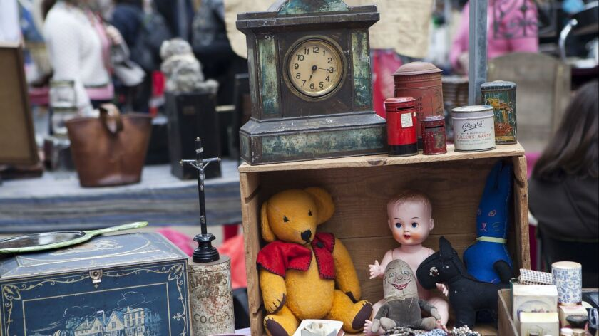 Assorted collectables or stage props for sale on a London street market stall