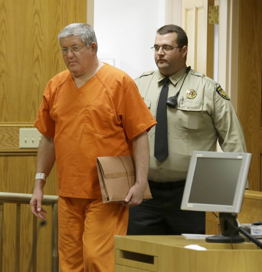 """FILE - In this May 6, 2014 file photo, Bernie Tiede walks into a court before a hearing granting his release at the Panola County court house in Carthage, Texas. When the East Texas mortician who inspired the movie """"Bernie"""" was let out of prison, family members of the elderly woman he killed found out about his release from reporters. Now, they're fighting to have their protests heard inside a courtroom. (AP Photo/LM Otero, File)"""