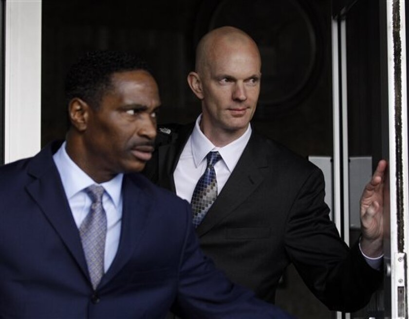 Federal Agent Jeff Novitzky, at right, is seen at the federal courthouse in San Francisco, Monday, March 21, 2011. (AP Photo/Marcio Jose Sanchez)