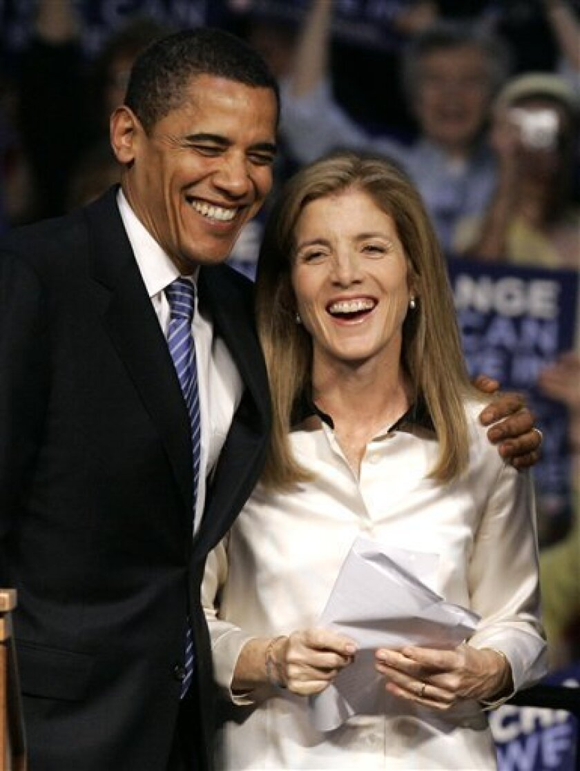 In this April 20, 2008 file photo, Democratic presidential candidate Sen. Barack Obama, D-Ill. shares a moment with Caroline Kennedy before addressing supporters at a rally in Scranton, Pa. The Kennedy clan wants to see their Caroline in the Senate seat soon to be vacated by Hillary Rodham Clinton. The family just needs to convince her to do it, and New York Gov. David Paterson to put her there. (AP Photo/Charles Rex Arbogast, File)