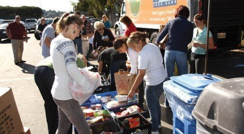 Local residents help sort food at the Community Resource Center Food Drive.