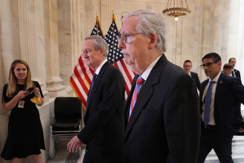 Senate Minority Leader Mitch McConnell and Sen. Mike Crapo leave a Senate Republican Policy Committee closed-door luncheon.