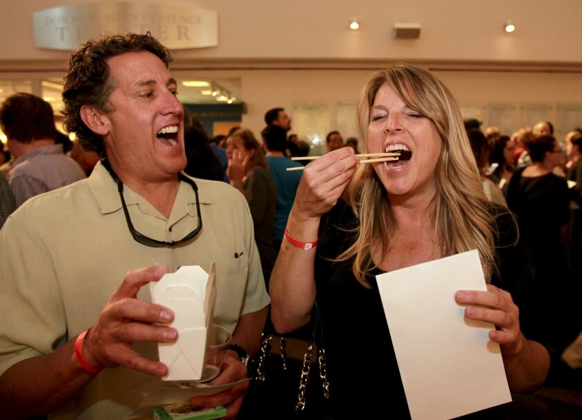 Cindy and David Orr sample the crispy curried crickets at the San Diego Natural History Museum's 'Bugs and Beer' event.