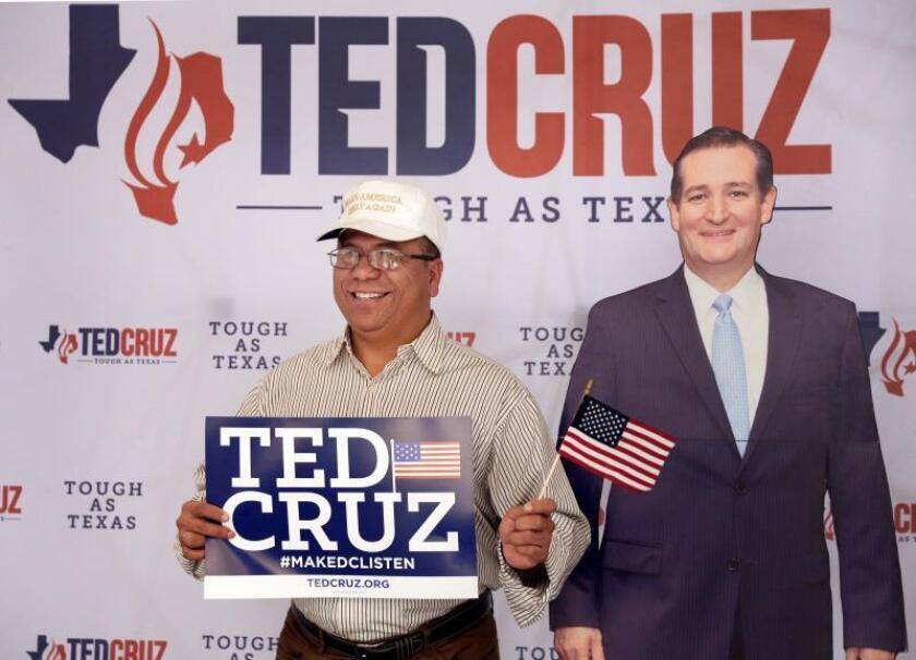 Martin Rodriguez has his photo made with a cardboard cutout of Ted Cruz at the election night headquarters in the 2018 midterm general election at the Hilton Post Oak in Houston, Texas, USA, 06 November 2018. Cruz and challenger Beto O'Rourke are in a tight and closely watched race. EPA-EFE/MICHAEL WYKE
