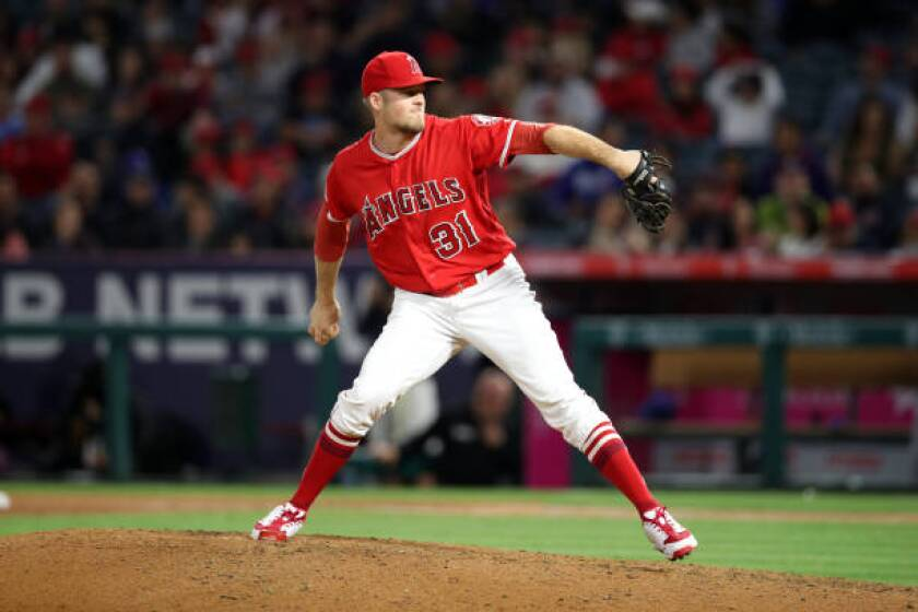 Angels reliever Ty Buttrey throws against the Texas Rangers on May 25.