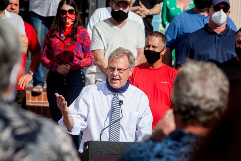 County Supervisor Jim Desmond speaks at a rally of small business owners