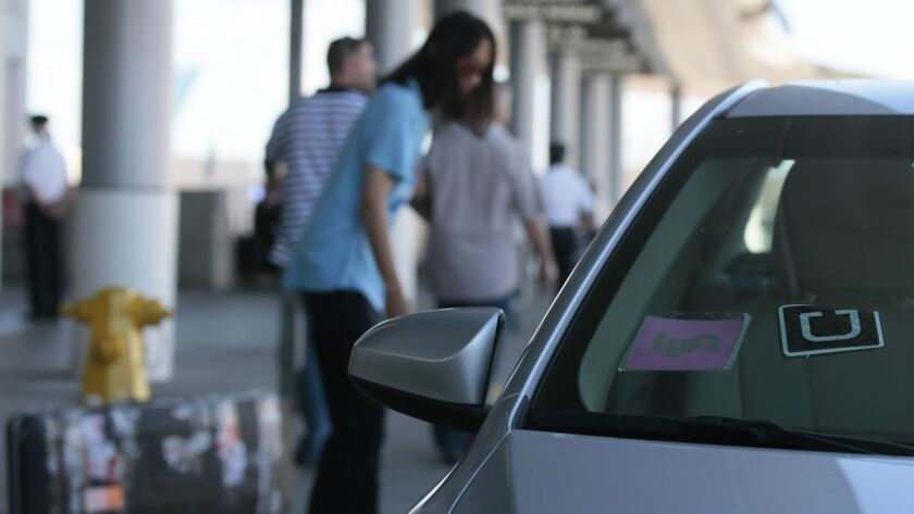 LOS ANGELES, CA, TUESDAY, OCTOBER 20, 2015 - Uber and Lyft cars drop off passengers at the Bradley