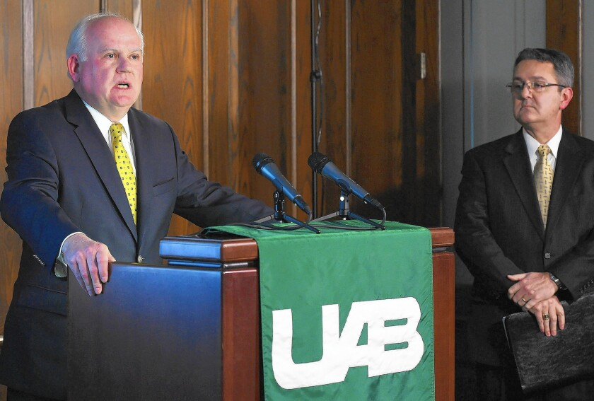 """""""Football is simply not sustainable,"""" says University of Alabama at Birmingham President Ray Watts, left."""
