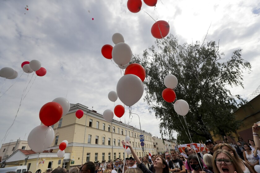 People release balloons in colors of old Belarusian national flag.