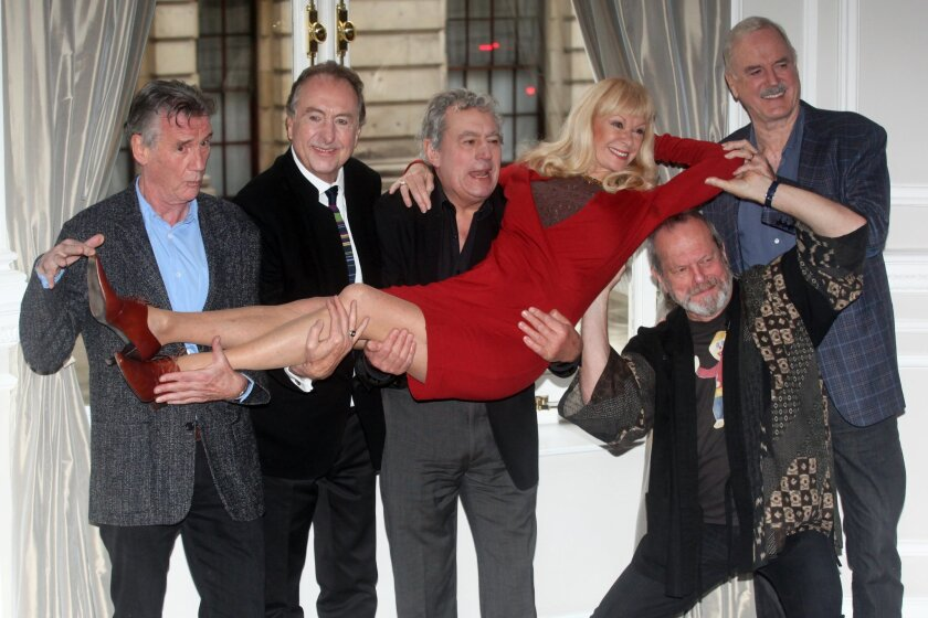 From left: Michael Palin, Eric Idle, Terry Jones, Terry Gilliam, Carol Cleveland and John Cleese of the comedy troop Monty Python are seen at a photo call, on Thursday, Nov. 21, 2013 in London. They are reuniting for a project. (Photo by Jim Ross/InvisionAP Images)