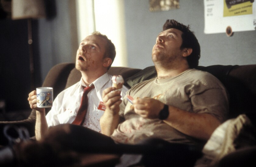 Simon Pegg (left) and Nick Frost (right) star in the movie SHAUN OF THE DEAD, a Rogue Pictures release.