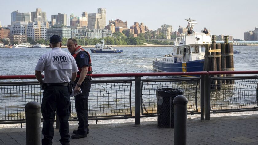 Authorities investigate the death of a baby boy who was found floating in the water near the Brooklyn Bridge on Aug. 5.