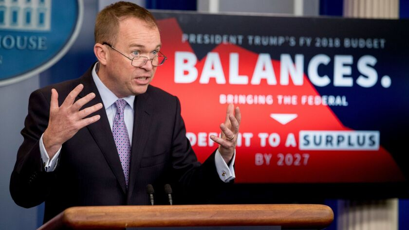 Budget Director Mick Mulvaney speaks to the media about President Trump's proposed 2018 budget at a White House news briefing Tuesday.