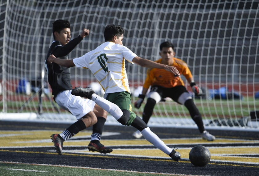 Patrick Henry's Julian Garcia (10) scores in the Patriots' win over Escondido on Satgurday for the San Diego Section Division III championship.