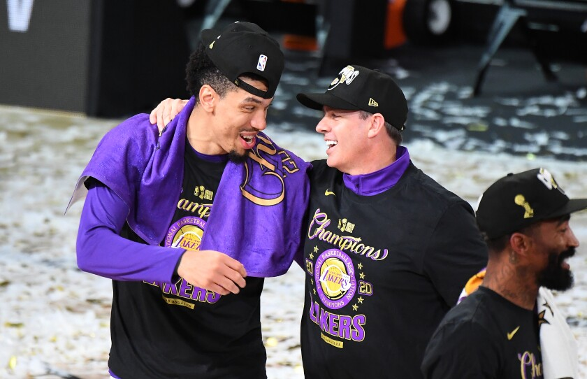 Lakers guard Danny Green and coach Frank Vogel celebrate after winning the NBA Finals over the Miami Heat.